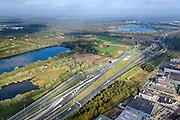Nederland, Noord-Brabant, Eindhoven, 24-10-2013; Knooppunt Ekkersweijer, kruising A50 met A2 (naar li).<br /> Ringroad Eindhoven, Ekkersweijer Junction<br /> luchtfoto (toeslag op standaard tarieven);<br /> aerial photo (additional fee required);<br /> copyright foto/photo Siebe Swart.
