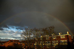© Licensed to London News Pictures. 03/01/2021. London, UK. A rainbow over a housing block in north London. It has snowed in many parts of England and the Met Office has issued a weather warning for ice and more snow as the 'Beast from the East II' could arrive in the UK in the coming next week. Photo credit: Dinendra Haria/LNP