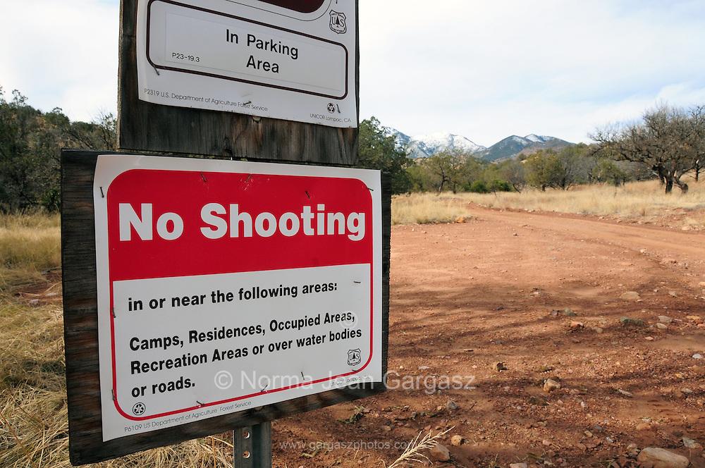 "A ""No Shooting"" sign along the Arizona Trail in Gardner Canyon in the Santa Rita Mountains of the Coronado National Forest in the Sonoran Desert north of Sonoita, Arizona, USA."