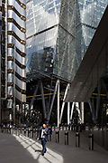 City workers walk through the modern architecture of Lloyds of London left and the Leadenhall Building right in the City of London, aka The Square Mile the capitals financial district, on 2nd September 2019, in London, England.