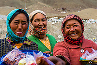 Women selling apricots, apples and dried fruit; Ladakh; Jammu and Kashmir State, India.