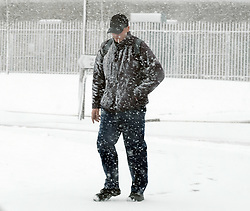 Heavy Snowfall in West Lothian, Wednesday, 4th April 2018<br /> <br /> More heavy snow fell in West Lothian this afternoon causing traffic problems for drivers on the M8 Edinburgh to Glasgow motorway.<br /> <br /> A worker walks home in the snow<br /> <br /> Alex Todd | EEm