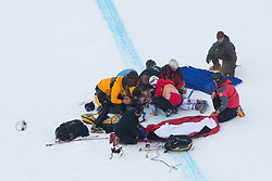 20.01.2011, Hahnenkamm, Kitzbuehel, AUT, FIS World Cup Ski Alpin, Men, Training, im Bild The mountain rescue medical team treat Hans Grugger (AUT)  after he crashed on the Mausefalle jump during the official training run for the 2011 Hahnenkamm Downhill race part of  Audi FIS World Cup races in Kitzbuhel Austria. EXPA Pictures © 2011, PhotoCredit: EXPA/ M. Gunn .