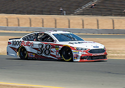 June 22, 2018 - Sonoma, CA, U.S. - SONOMA, CA - JUNE 22:  David Ragan, driving the #(38) Ford for Front Row Motorsports speeds through turn 10 on Friday, June 22, 2018 at the Toyota/Save Mart 350 Practice day at Sonoma Raceway, Sonoma, CA (Photo by Douglas Stringer/Icon Sportswire) (Credit Image: © Douglas Stringer/Icon SMI via ZUMA Press)