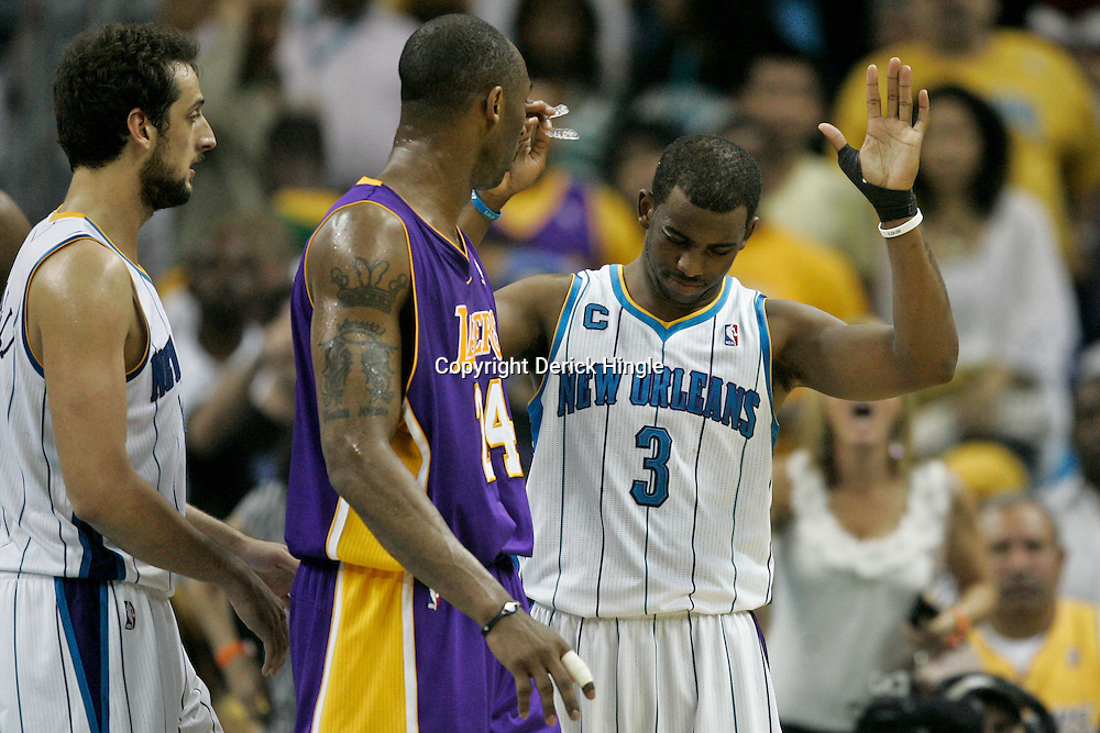 April 24, 2011; New Orleans, LA, USA; New Orleans Hornets point guard Chris Paul (3) reacts to Los Angeles Lakers shooting guard Kobe Bryant (24) during the second quarter in game four of the first round of the 2011 NBA playoffs at the New Orleans Arena.    Mandatory Credit: Derick E. Hingle
