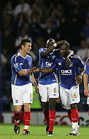 Photo: Lee Earle.<br /> Portsmouth v Leeds United. Carling Cup. 28/08/2007.David Nugent (L) and Djimi Traore congratulate Noe Pamarot (R) after he scored Portsmouth's second goal.