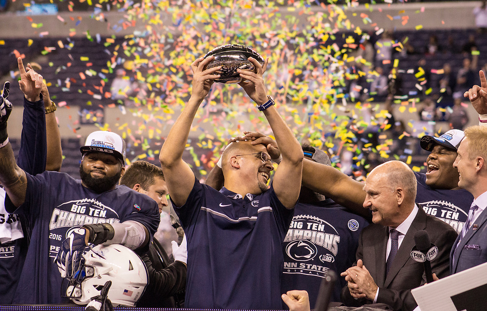 The Penn State Nittany Lions celebrate after defeating the Wisconsin Badgers for the Big 10 Championship on December 3, 2016.