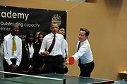 Barack Obama and David Cameron team up to play pupils at table tennis at the Globe Academy school on May 24th in London, United Kingdom. The US president and British Prime Minister visited the school on Obamas first day in the country on his state visit.