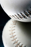 Closeup photographs of a softball on a mirror with a dark background Closeup photograph of a softball and reflection