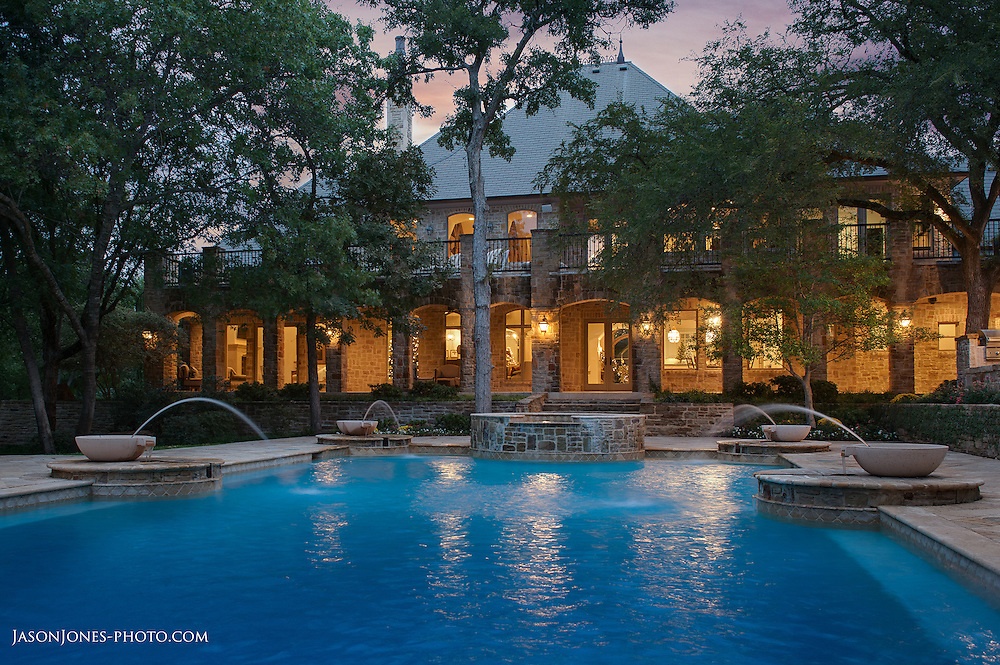 Large traditional home backyard entertainment area with a custom pool, jacuzzi, and fountains