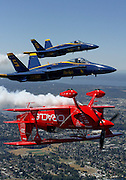 An aerobatic pilot in his Team Oracle plane, flies in formation over Seattle with the Blue Angels. (Greg Gilbert / The Seattle Times, 2015)