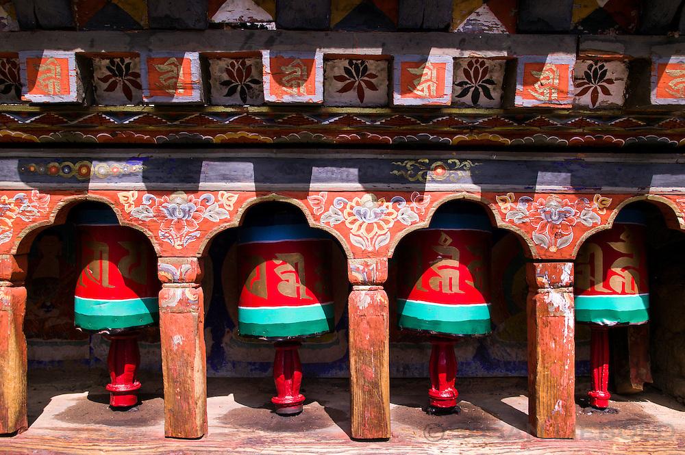 Prayer wheels at the Kyichu Lhakhang temple in Paro, Bhutan.
