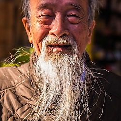 Old men in Hanoi. The Ho Chi Minh 'look' seems still to be in fashion to day!