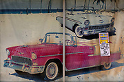 Photo of vintage cars on garage forecourt with circus flyer announcement on 28th February 2020 in Wisner, Mississippi, United States.