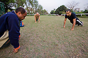 George Bahna (in black t-shirt), an engineering company executive and martial arts instructor  Kung Fu training and teaching two students at the Gezira Club in Zamelek, Cairo, Egypt.  (George Bahna is featured in the book What I Eat: Around the World in 80 Diets.)  He is 29 years of age; 5 feet, 11 inches tall; and 165 pounds.