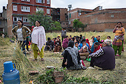 Devastating April 2015 Nepal Earthquake. Panga Village, Kirtipur, Kathmandu Valley, a few hours after the earthquake struck. People gathered in a open field in fear of aftershocks and more houses collapsing.