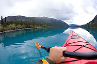 Kayaking on Chilko Lake. BC, Canada.