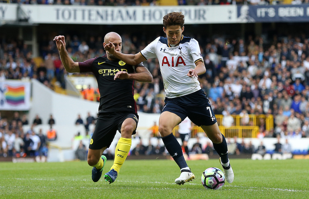 Tottenham Hotspur's Son Heung-Min and Manchester City's Pablo Zabaleta<br /> <br /> Photographer Rob Newell/CameraSport<br /> <br /> The Premier League - Tottenham Hotspur v Manchester City - Sunday October 2nd 2016 - White Hart Lane - London<br /> <br /> World Copyright © 2016 CameraSport. All rights reserved. 43 Linden Ave. Countesthorpe. Leicester. England. LE8 5PG - Tel: +44 (0) 116 277 4147 - admin@camerasport.com - www.camerasport.com