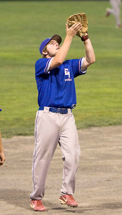 MIDDLETOWN, CT - 09 AUGUST 2010 -.East Longmeadow Post 293's Colin O'Neil catches a fly ball hit by Branford Post 83's Buddy Shea during Monday's American Legion Northeast Regional Tournament Championship game at Palmer Field in Middletown. East Longmeadow lost, 2-1..Photo by Josalee Thrift