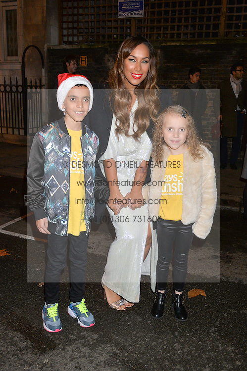 Singer LEONA LEWIS with TIA PRICE and HAYDEN PRICE at the Quintessentially Foundation and The Crown Estate's Fayre of St.James' on 27th November 2014.  The evening started with a christmas concert at St.James's Church, Piccadilly.  Following the concert singer Leona Lewis switched on the Jermyn Street Christmas lights and then guests had a party at the newly refurbished Quaglino's, 16 Bury Street, London