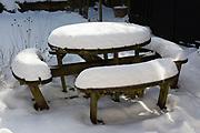Heavy snow February 2020 village of Shottisham, Suffolk, England, UK - thick snow on garden table