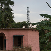 CAPTION: A cell tower, anchor load for renewable energy provided by DESI Power. LOCATION: Araria District, Bihar, India. INDIVIDUAL(S) PHOTOGRAPHED: N/A.