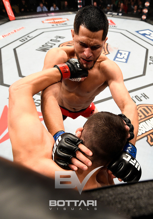LAS VEGAS, NV - DECEMBER 03: (L-R) Jorge Masvidal battles Jake Ellenberger in their welterweight bout during The Ultimate Fighter Finale event inside the Pearl concert theater at the Palms Resort & Casino on December 3, 2016 in Las Vegas, Nevada. (Photo by Jeff Bottari/Zuffa LLC/Zuffa LLC via Getty Images)