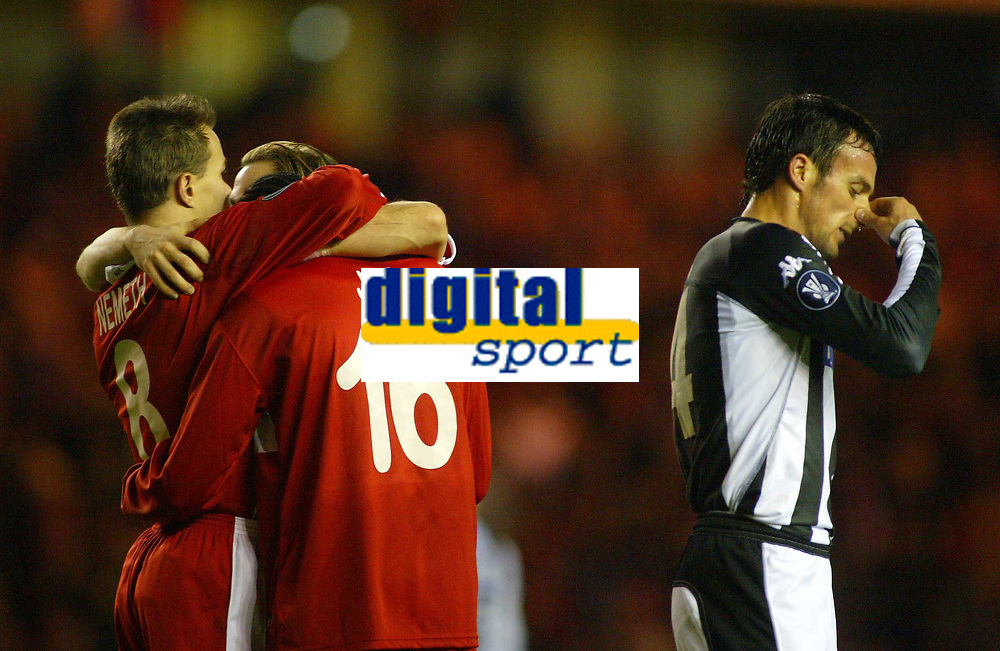 15/12/2004 - UEFA Cup, Group E - Middlesbrough v FK Partizan - The Riverside, Middlesbrough<br />FK Partizan Belgrade's Nenad Djordjevic clears his nose in disgust as the Middlesbrough players celebrate by surrounding Joseph-Desire Job after he scores the second goal of the night.<br />Photo:Jed Leicester/Back Page Images