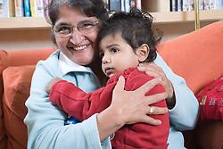 Grandmother holding grandson,