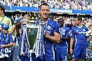 Chelsea Captain John Terry with the Premier League Trophy. Premier league match, Chelsea v Sunderland at Stamford Bridge in London on Sunday 21st May 2017.<br /> pic by Steffan Bowen,  Andrew Orchard sports photography.