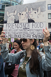 An animal rights activist takes part in a National Animal Rights March on 28th August 2021 in London, United Kingdom. Animal Rebellion, an offshoot of Extinction Rebellion, organised the march for the sixth day of Extinction Rebellion's protests in London, with stops at Smithfield meat market, Unilever (which owns brands that sell dairy products and use palm oil), Cargill (which is one of the world's largest meat processors) and the Marine Stewardship Council.