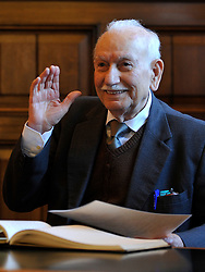 """© Licensed to London News Pictures. 02/02/2012, Kingston Upon Thames,UK. 104 year-old becomes Britain's oldest new citizen. 104 year-old TAUFEEK KHANJAR became a British Citizen at a ceremony held by Surrey County Council today (01 February 2012). Mr Khanjar is originally from Iraq and worked as a jewellery maker in Baghdad. He came to the UK six years ago to live with his daughter Nada Dabis, 59, in South Cheam, Surrey, where he enjoys walking, feeding the birds, playing cards and listening to music. He is a widower with four sons and two daughters. Durning the ceremony Mr Khanjar took an oath to the Queen, pledging that he will be a faithful citizen and obey the laws of the country. He explained the secret to a long and healthy life was to """"never get stressed and be relaxed"""".  Photo credit : Stephen Simpson/LNP"""