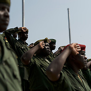 A group of SPLA commanders stand for the national anthem during a mock parade in preparation for the official ceremony marking the independence of South Sudan.