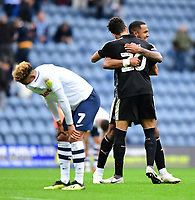 Reading's Liam Moore, right, celebrates the win with team-mate Tiago Ilori as Preston North End's Callum Robinson looks away<br /> <br /> Photographer Chris Vaughan/CameraSport<br /> <br /> The EFL Sky Bet Championship - Preston North End v Reading - Saturday 15th September 2018 - Deepdale - Preston<br /> <br /> World Copyright © 2018 CameraSport. All rights reserved. 43 Linden Ave. Countesthorpe. Leicester. England. LE8 5PG - Tel: +44 (0) 116 277 4147 - admin@camerasport.com - www.camerasport.com
