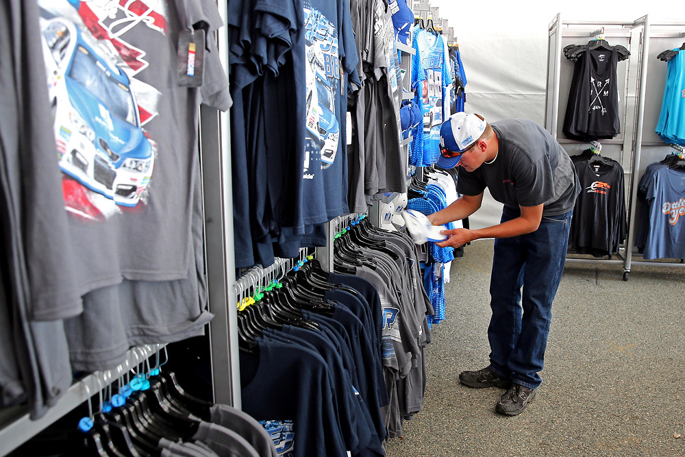 Apr 30, 2017; Richmond, VA, USA; Kenny Klipp of Fredrick, MD looks at merchandise for NASCAR Cup Series driver Dale Earnhardt Jr. (88) before the Toyota Owners 400 at Richmond International Raceway. Mandatory Credit: Peter Casey-USA TODAY Sports