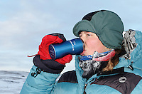 Girl drinking hot chocolate too keep warm during a breake