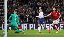Manchester United goalkeeper David de Gea blocks a shot from Tottenham Hotspur's Dele Alli