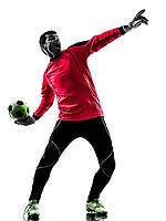 one  soccer player goalkeeper man throwing ball in silhouette isolated white background
