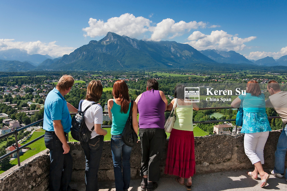 Tourists watching mountain and cityscape of Salzburg from Fortress Hohensalzberg, Salzburg, Austria