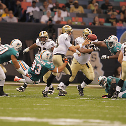 2008 August 28: Quarterback, Tyler Palko (3) of the New Orleans Saints flicks the ball away to avoid a sack by Rob Ninkovich (93) of the Miami Dolphins during a preseason game at the Louisiana Superdome in New Orleans, LA.