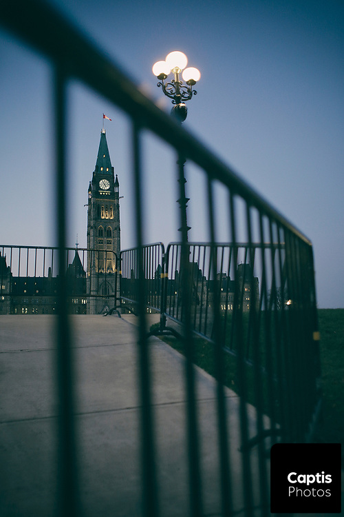 Parliament Hill in Ottawa framed by a security fence.
