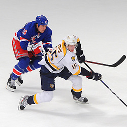 Nashville Predators center Craig Smith (15) makes drives out of his defensive zone under pressure by New York Rangers left wing Ruslan Fedotenko (26) during third period NHL action between the New York Rangers and the Nashville Predators at Madison Square Garden in New York, NY.
