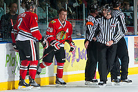 KELOWNA, CANADA - APRIL 25: Mike Langin, linesman, takes Brendan Leipsic #28 of the Portland Winterhawks to the dressing room after a late game penalty against the Kelowna Rockets on April 25, 2014 during Game 5 of the third round of WHL Playoffs at Prospera Place in Kelowna, British Columbia, Canada. The Portland Winterhawks won 7 - 3 and took the Western Conference Championship for the fourth year in a row earning them a place in the WHL final.  (Photo by Marissa Baecker/Getty Images)  *** Local Caption *** Brendan Leipsic; Mike Langin;