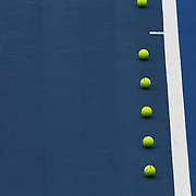 Tennis balls are lined up on centre court as technical calculations are made in preparation for the Medibank International Sydney Tennis Tournament on January 10, 2009 in Sydney, Australia. Photo Tim Clayton