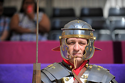 © Licensed to London News Pictures. 26/08/2017. London, UK. A man dressed as a Roman centurion joins members of the Brittania re-enactment group putting on Gladitorial Games in Guildhall Yard, the site of London's only Roman Amphitheatre.  The Gladiator Games will be entertaining crowds over the August Bank Holiday Weekend. Photo credit : Stephen Chung/LNP