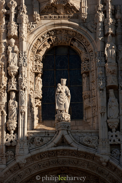 A statue above the main entrance to Jeronimos Monastery in the early hours of the morning in Lisbon, Portugal. Jeronimoes Monastery is listed as an UNECSO Heritage Site,