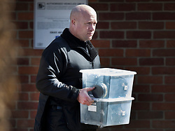 © Licensed to London News Pictures. 21/03/2018. Salisbury, UK. A policeman carries a box into The Mill pub as police continue their investigation after the poisoning of former Russian spy Sergei Skripal and his daughter Yulia . The couple where found unconscious on bench in Salisbury shopping centre. A policeman who went to their aid is currently recovering in hospital. Photo credit: Peter Macdiarmid/LNP
