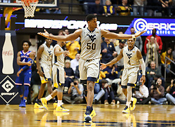 Jan 15, 2018; Morgantown, WV, USA; West Virginia Mountaineers forward Sagaba Konate (50) reacts to the crowd during the first half against the Kansas Jayhawks at WVU Coliseum. Mandatory Credit: Ben Queen-USA TODAY Sports