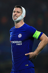 Chelsea's Gary Cahill wears a bandage on his head