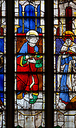Sixteenth century stained glass windows inside church of Saint Mary, Fairford, Gloucestershire, England, UK - window 17 Saint Luke